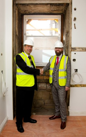 General Manager Craig Miller and the Lord Provost shake hands the original doorways - low res